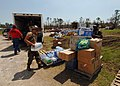 US Navy 050908-N-4374S-009 U.S. Navy Seabees assigned to Naval Mobile Construction Battalion Seven (NMCB-7), distribute relief supplies to the residents of Harrison County.jpg