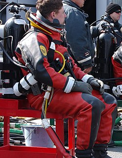 US Navy 060329-F-3759D-001 U.S. Navy divers assigned to the rescue and salvage ship USS Safeguard (ARS 50) prepare to dive (cropped).jpg