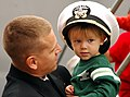 US Navy 061017-N-1831S-223 An officer aboard the guided-missile destroyer USS James E. Williams (DDG 95) hugs his child after returning from deployment.jpg