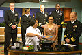 US Navy 070316-N-6247V-007 Sailors from USS Carl Vinson (CVN 70) stand behind local Atlanta WAGA Fox 5 morning anchor Suchita Vadlamani, while Culinary Specialist 1st Class Maria Velo demonstrates her culinary skills.jpg