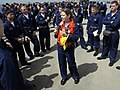 US Navy 070327-N-1328S-002 Intelligence Specialist 2nd Class Jessica Bacak assigned to the amphibious assault ship USS Boxer (LHD 4), instructs a group of Sailors on how to properly don a life jacket during an abandon ship dril.jpg