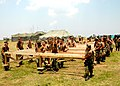 US Navy 070612-N-0553R-001 Seabees stationed with Naval Mobile Construction Battalion (NMCB) 1 work as one to move the foundation of a strongback battalion aid station during a camp build up.jpg