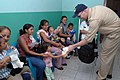 US Navy 070728-N-7088A-224 Senior Chief Operations Specialist Gene Demers, attached to the Military Sealift Command hospital ship USNS Comfort (T-AH 20), hands out teddy bears to children at Unidad de Salud Health Center in Aca.jpg