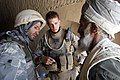 US Navy 080730-M-1341G-055 .S. Navy Hospitalman Apprentice Brian Rumbles, assigned to Golf Company, 2nd Battalion, 7th Marine Regiment, examines a local Afghani at a temporary medical clinic to assist a local village.jpg