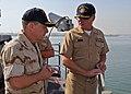 US Navy 090126-N-1082Z-020 Vice Adm. Bill Gortney speaks with Capt. Mark D. Genung.jpg