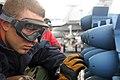 US Navy 090304-N-6597H-093 Aviation Ordnanceman Airman Mark Mills, from Chicago, arms MK-76 practice bombs aboard the Nimitz-class aircraft carrier USS John C. Stennis (CVN 74).jpg