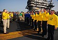 US Navy 090306-N-7571S-001 Flight deck officer Lt. Cmdr. Ronald Rancourt and shooter Lt. Jade Maguigad re-enlist 11 Aviation Boatswain's Mates (Handling) aboard the aircraft carrier USS Theodore Roosevelt (CVN 71).jpg