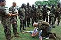 US Navy 090324-N-1655H-100 Marine Staff Sgt. Jason Elsdon demonstrates procedures for treating battle wounds to Nigerian infantrymen during an Africa Partnership Station combat lifesaving course.jpg