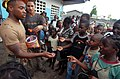 US Navy 090422-N-1688B-424 teelworker 1st Class Kajuna Strickland, left, and Information Systems Technician 3rd Class Cameran Heckenlaible hand out candy to children at the Balise School in Port Gentl during an Africa Partnersh.jpg