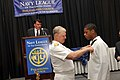 US Navy 090624-N-8273J-109 Chief of Naval Operations (CNO) Adm. Gary Roughead, presents Ramee Gregory with the Navy League Youth Medal during the 2009 annual Navy League Dinner in Philadelphia, Penn.jpg