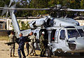 US Navy 100128-N-8366W-194 U.S. Navy Capt. Richard Sharpe helps U.S. Army Soldiers assigned to the 82nd Airborne Division, based in Fort Bragg, N.C., unload stretchers from an SH-60S Sea Hawk helicopter.jpg