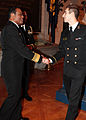 US Navy 100211-N-3066M-421 Vice Adm. D.C. Curtis congratulates Midshipman 1st Class Christopher L. Laird, from El Paso, Texas, on his choice of orders during Ship Selection Night.jpg