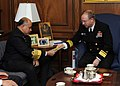 US Navy 100326-N-9852I-003 Rear Adm. Phil Wisecup, president of the Naval War College, hands a book that lists all of the international college graduates to Adm. Noman Bashir.jpg