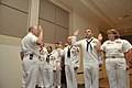 US Navy 100825-N-3548M-105 Chief of Naval Operations (CNO) Adm. Gary Roughead reenlists a group of Sailors after meeting with senior leadership at Buckley Air Force Base in Colorado.jpg