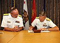 US Navy 101015-N-7214P-015 Commanders sign a memorandum of understanding transitioning operating and installation management control from Naval Med.jpg