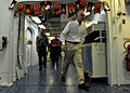 US Navy 101031-N-1531D-089 Dutch Ambassador to Suriname Aart Jacobi walks through the passageways of the medical department aboard the multi-purpos.jpg