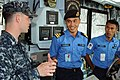 US Navy 110518-N-SP676-042 Mineman 2nd Class Dana Baynard explains daily bridge operations aboard the mine countermeasures ship USS Avenger (MCM 1).jpg