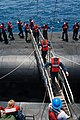 US Navy 110720-N-FG395-028 Navy ROTC midshipmen transfer from the Ohio-class ballistic-missile submarine USS Rhode Island (SSBN 740) to the Militar.jpg