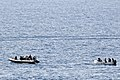 US Navy 110812-N-YM590-132 Members of a visit, board, search and seizure team from the guided-missile cruiser USS Anzio (CG 68) assist mariners abo.jpg
