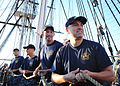 US Navy 110823-N-AU127-252 Chief selectees on the USS Constitution haul on a halyard.jpg