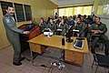 US Navy 110906-N-IZ292-030 Wing Cmdr. Misra Shashank gives a brief to Naval aviators and Sailors during a visit to the Mauritius Police Force Helic.jpg