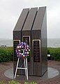 US Navy 111012-N-NW885-024 A wreath is placed at the USS Cole memorial at Naval Station Norfolk during an annual remembrance ceremony.jpg