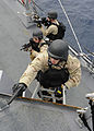 US Navy 111108-N-VH839-024 Sailors conduct a visit, board, search, and seizure training exercise aboard the Arleigh Burke-class guided-missile dest.jpg