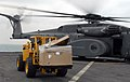 US Navy 111130-N-GH121-282 oatswain's Mate 3rd Class Ronnie Guerra operates a forklift to unload supplies from a MH-53E helicopter from Helicopter.jpg