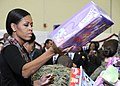US Navy 111216-F-ZE674-269 First lady Michelle Obama visits Joint Base Anacostia-Bolling, to sort toys for the Toys for Tots charity.jpg