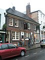 Umbrellas up outside The Red Lion - geograph.org.uk - 1659279.jpg