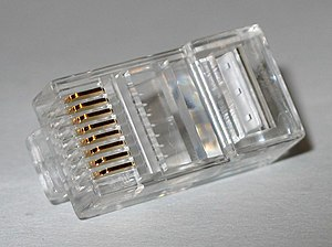 Modular connector - An 8P8C modular plug. This is the common crimp type plug, of the same kind pictured above crimped onto a cable (with moulded sleeve)