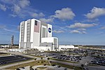 VAB with Falcon Heavy taking off in the background 02.jpg