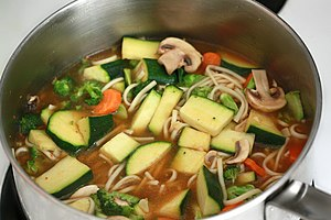 Vegetable soup - A vegetable and noodle soup being cooked