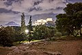 View of the Acropolis and Mount Lycabettus from the Pnyx at night.jpg