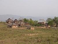 Village huts near Iliomar on the Iliomar-Uatu kerbau road, Lautem, 8 Apr 2003.jpg