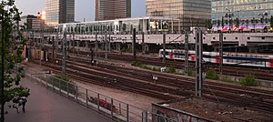 The tracks to Gare d'Austerlitz (seen here with a suburban train) run south of the Bibliothèque nationale de France`.