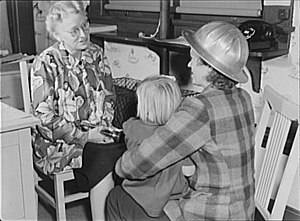Rosie the Riveter/World War II Home Front National Historical Park - Midnight-shift shipyard worker Arlene Corbin (right) brings her daughter to a day care facility before going home to sleep