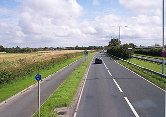 A565 road - Image: Warning of lane reduction on the A565 at Holmes (geograph 3076846)