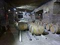 Wine barrels in old cellars on boards.jpg