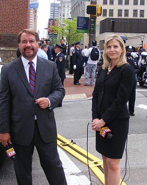 WJZ-TV - WJZ anchors Don Scott and Jessica Kartalija preparing for a live-shot during the funeral of former Maryland Governor William Donald Schaefer, April 28, 2011.