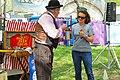 Woman helping Dardenell - Alberti Flea Circus, MerleFest 2013.jpg