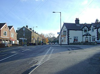 Worrall - The centre of Worrall with the Blue Ball pub on the right and local shops on the left.
