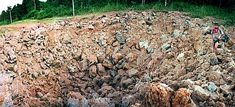 Unexploded ordnance - Bomb crater left after a circa 1000 lb (0.4 tonne) US Air Force UXO exploded without warning in southern Laos