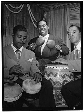Bongo drum - José Mangual Sr. on bongos (left) alongside Machito on maracas and Carlos Vidal on conga at the Glen Island Casino, New York, 1947.