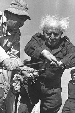 Mivtahim - David Ben-Gurion building a security fence in Mivtahim in 1956