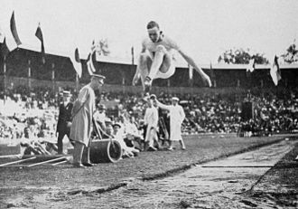 Athletics at the 1912 Summer Olympics – Men's long jump - Gutterson on the way to win the gold medal.