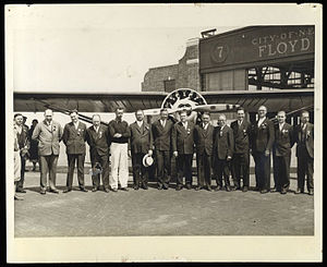Lituanica - 1933 rare original photograph of the Committee of Greater New York sponsoring the Darius-Girenas Transatlantic flight, in front of the orange Belanca plane Lituanica at Floyd Bennett Field, Brooklyn, New York, taken a week before the take-off on July 15th (at extreme left is A. Mažeika, who initiated the issuance of the special flight benefitting stamps; both pilots are to the right or left of the plane at center).
