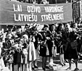 1944-10-16. Rigans welcome the Soviet soldiers of the 130th Latvian Rifle Corps.jpg
