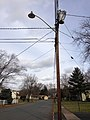 2014-12-30 12 45 38 Utility pole and an old incandescent street light fixture attached to a more modern support along Bittersweet Road in Ewing, New Jersey.JPG