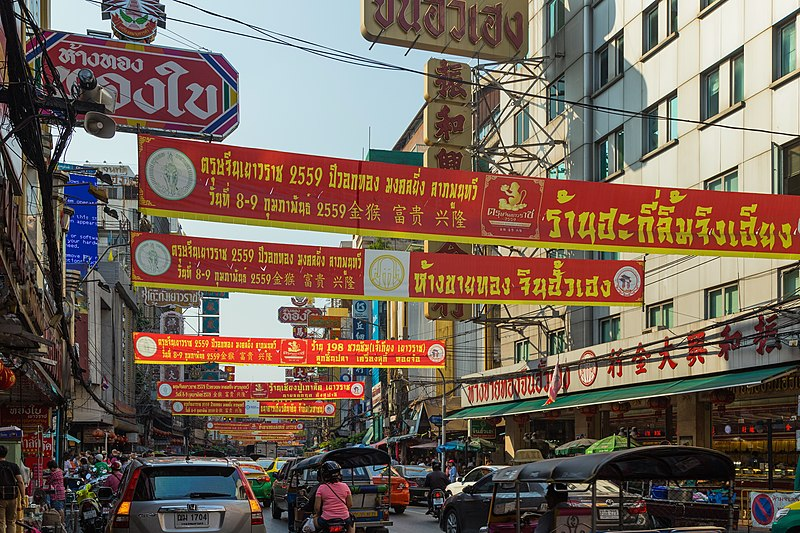 Greeting banners of various companies in the Chinese New Year 2016, on Yaowarat Road. Samphanthawong District, Bangkok, Thailand. (27 February 2016, 10:05)